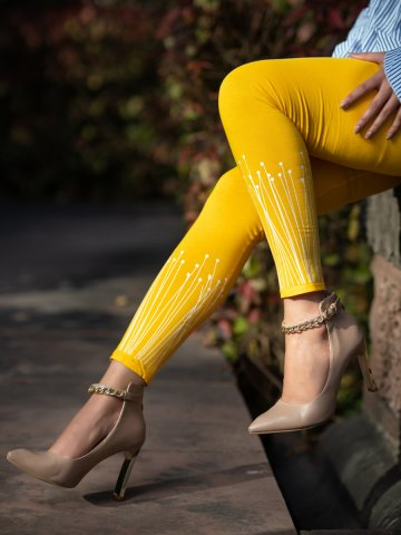 https://static4.cilory.com/407535-thickbox_default/psyna-yellow-printed-leggings.jpg
